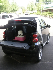 Delivering a wedding cake in our new SmartCar!
